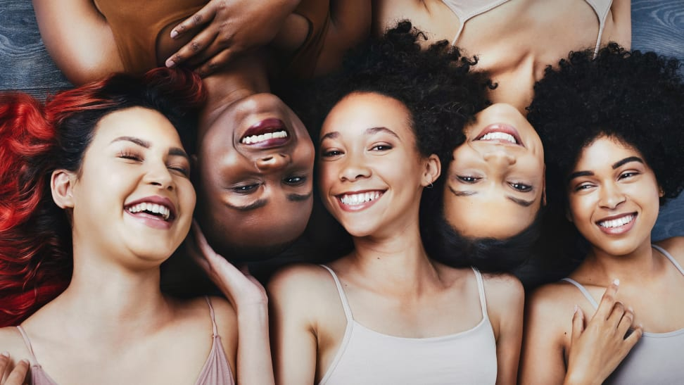 Five women with curly hair