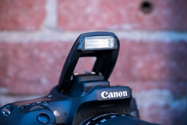 The build-in flash will help aid in low-light situations since the kit lens isn't doing it any favors.