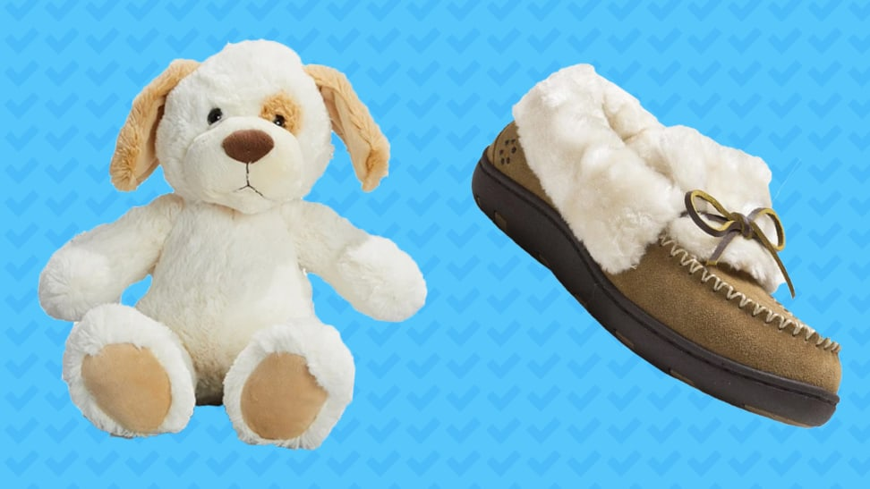 A stuffed dog and a slipper on a blue background