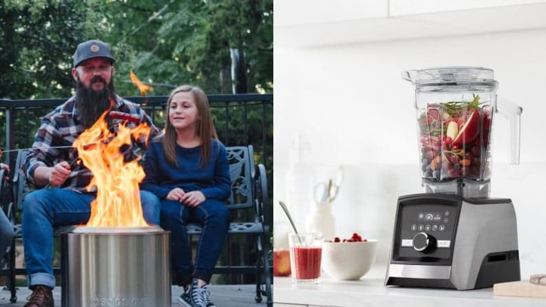 Dad and daughter roasting marshmallows over the Solo Stove / Vitamix blender on a counter filled with fruit and vegetables.