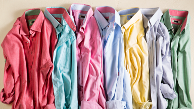 Pile of wrinkled dress shirts in a rainbow of colors