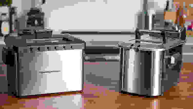 A Hamilton Beach Deep Fryer and Breville the Smart Fryer sit on a kitchen counter.