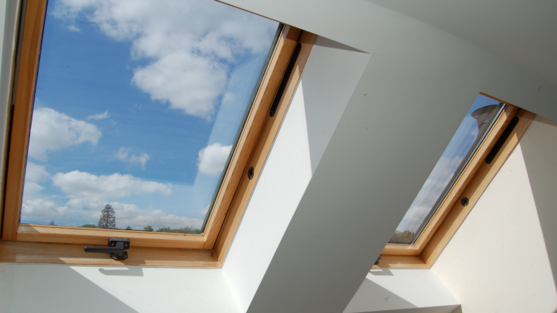 Two skylight windows on ceiling, letting in natural sunlight.