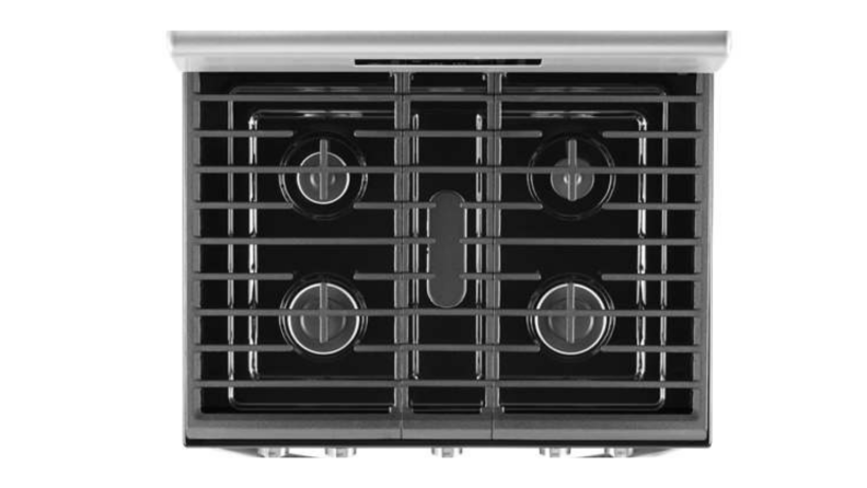 A top-down look at the Whirlpool gas range's five burners, which is covered by three cast-iron grates.