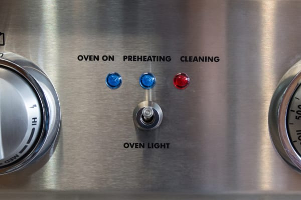 Controls, oven light switch, and oven indicator lights