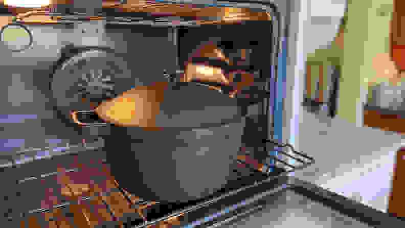 Inside an KitchenAid oven, there's a Perfect Pot in char (black) on the lower rack.