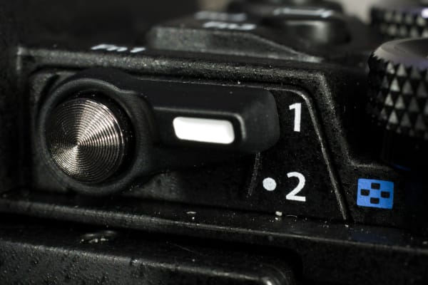 The handy 2x2 control system makes it way to the midrange OM-D and it works great.
