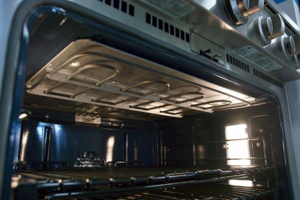 GE Monogram ZDP364NDPSS broiler in oven