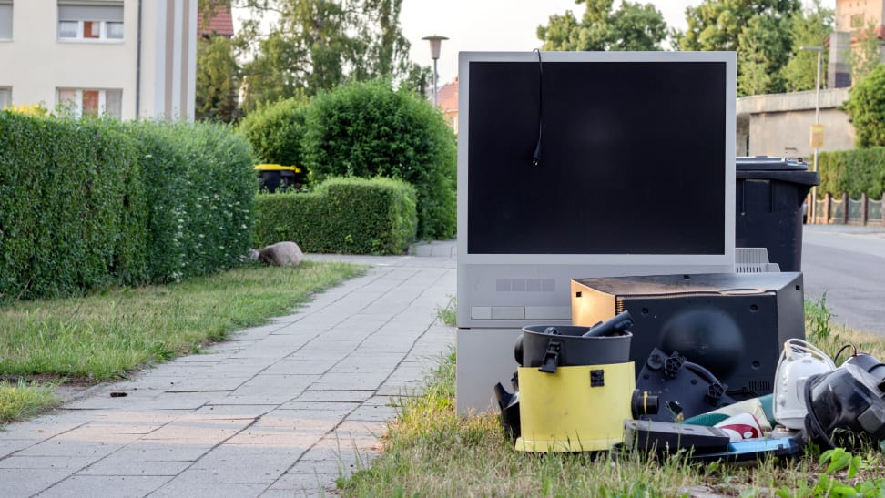 An old TV on the side of the road
