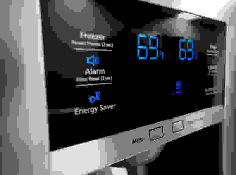 The blue display only makes the Samsung RF28HMEDBSR's glossy black control panel look all the more stylish.