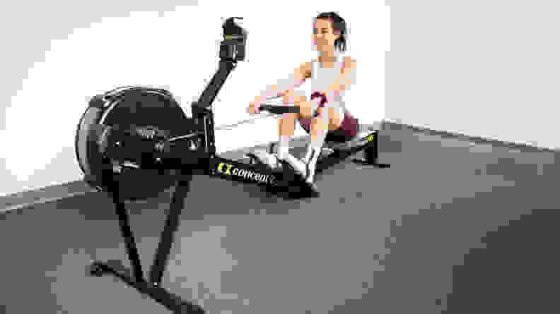 Women exercising on concept2 rowerg.