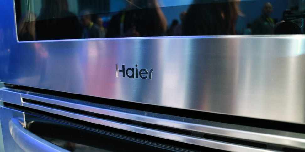 Closeup of the Haier logo on its full-size double wall oven