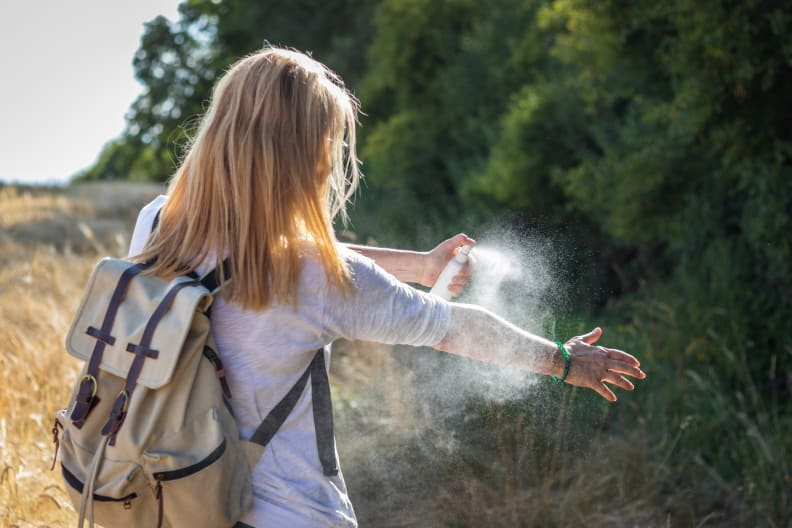 Woman spraying bug spry