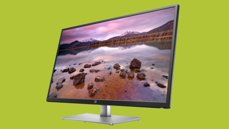 An image of an HP monitor that's at an angle, featuring a nature landscape as the monitor's background.