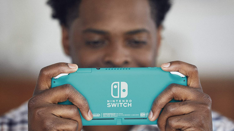 A person plays with a handheld Nintendo Switch