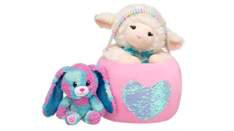 A plush Easter basket includes stuffed animals of a dog and lamb.