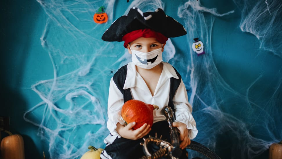Little boy in pirate costume with mask