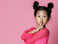 Little girl telling someone to be quiet