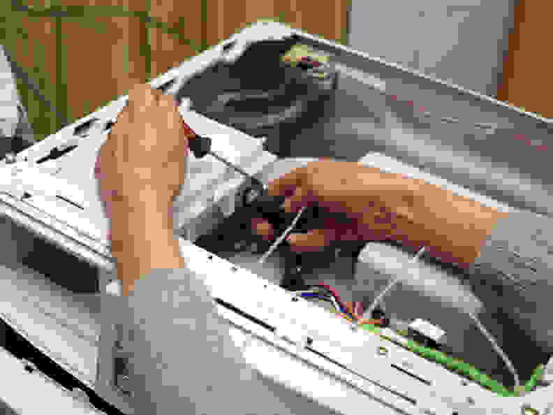Repairing a washing machine at home