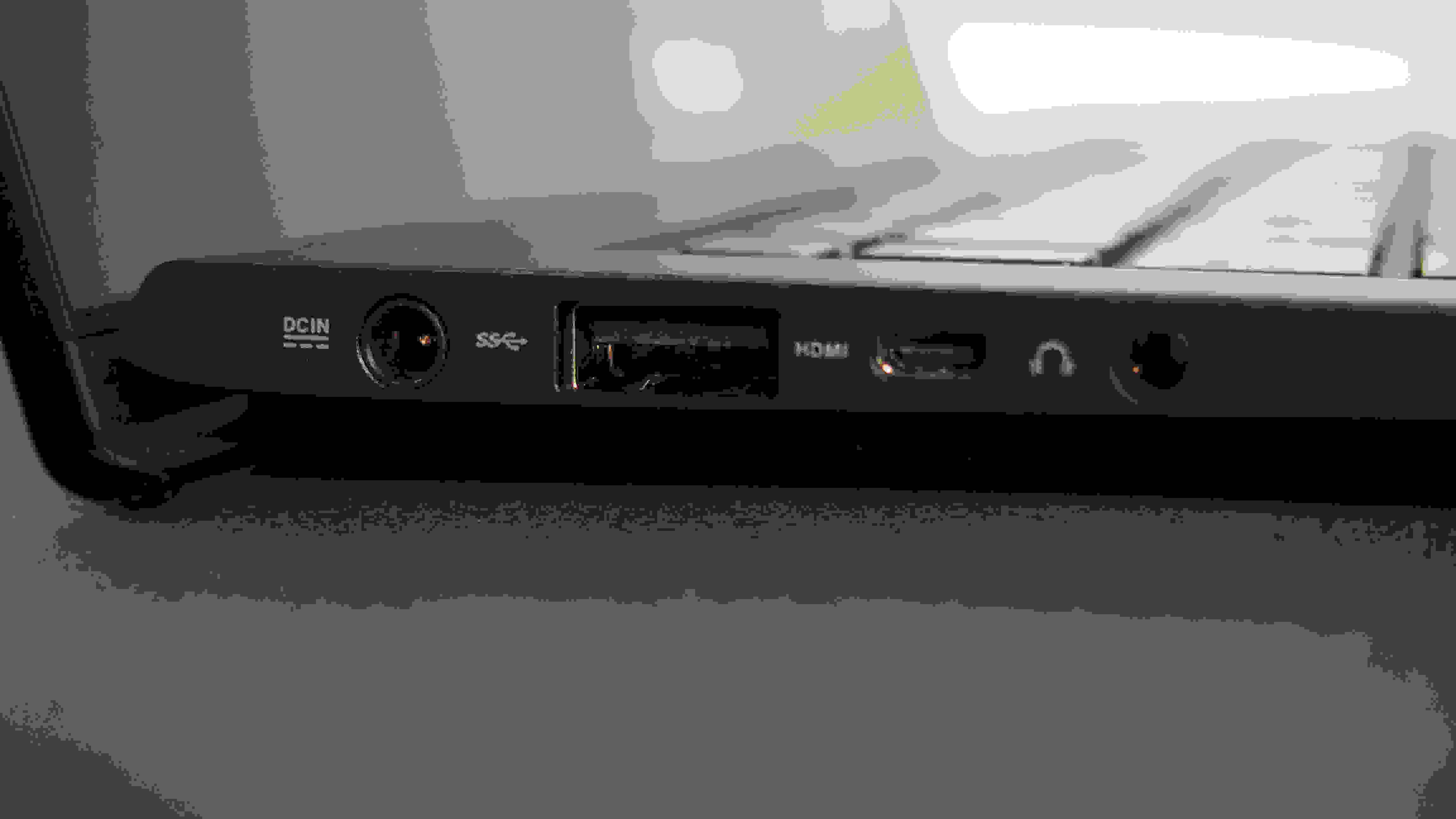 The left side of the UX301LA has a power input, a USB 3.0 port, a mini-HDMI input, and a headphone jack.