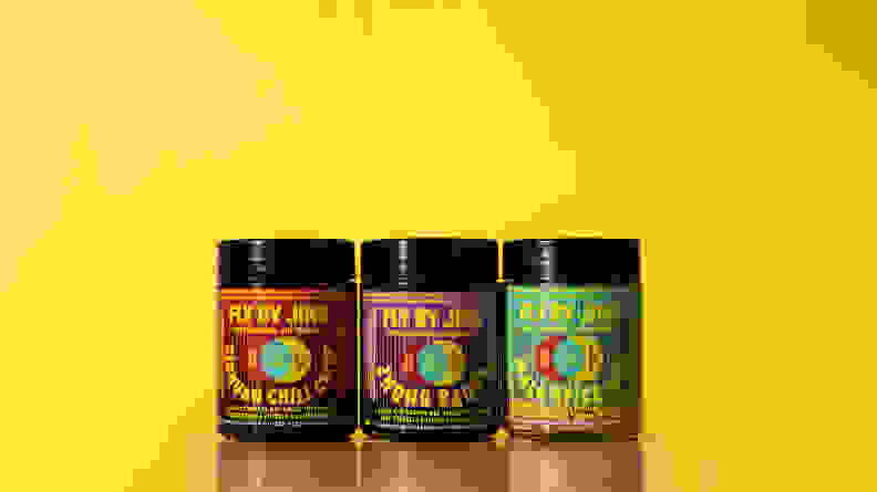 There are three jars of sauces and spice blends by Fly By Jing. From the left, there's the Sichuan Chili Crisp, Zhong Sauce, and Mala Spice Mix.