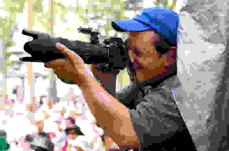 Photographer using a Nikon D200 at the 2007 Calgary Folk Music Festival.
