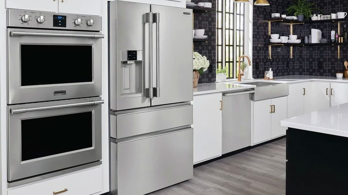 The Frigidaire Pro PRMC2285AF counter-depth French-door refrigerator, set up in a fancy kitchen alongside many other Frigidaire appliances.