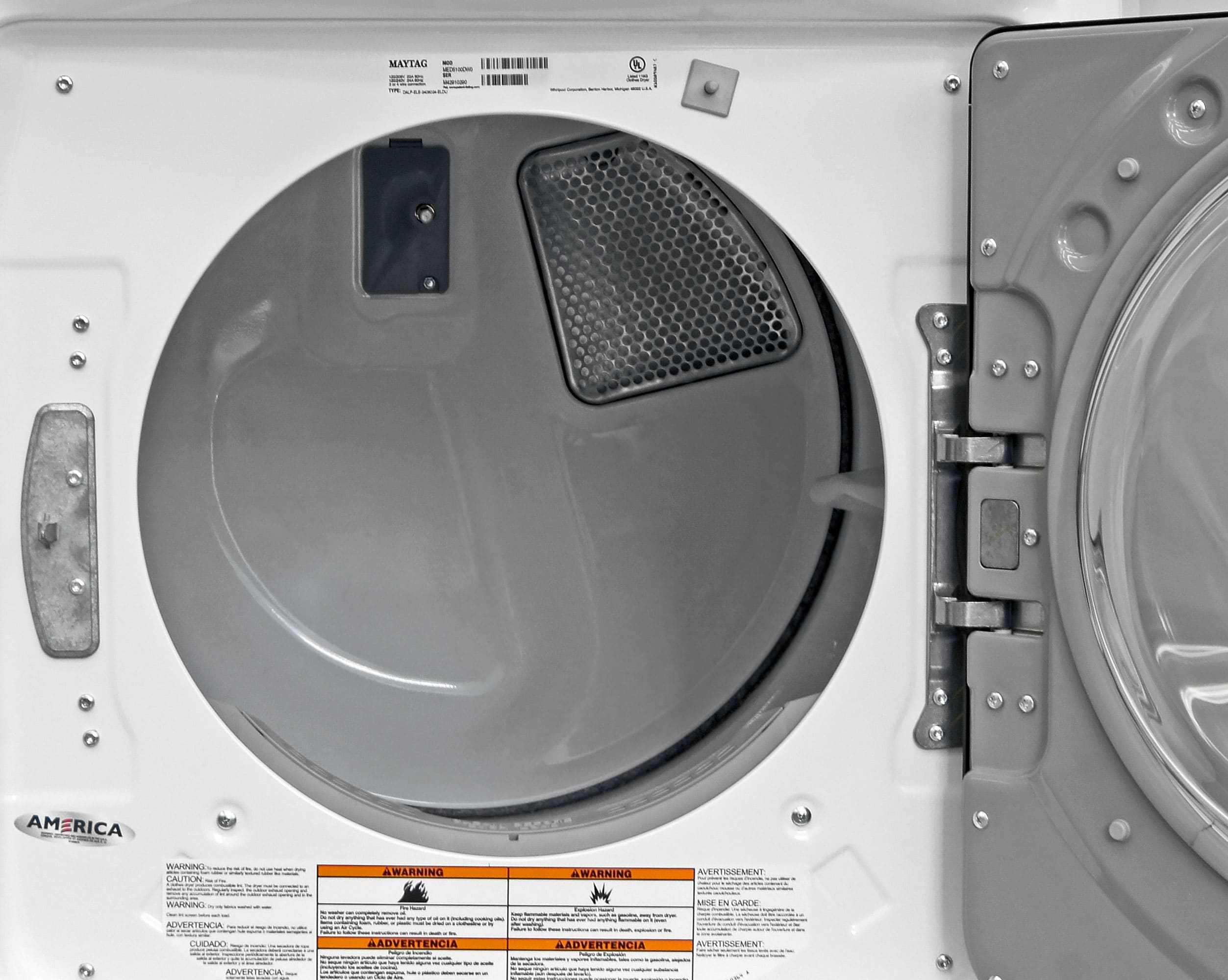 White plastic dryer drums—like the one found in the Maytag Maxima MED5100DW—are typically less sound proof and more prone to rusting or flaking compared to stainless ones.