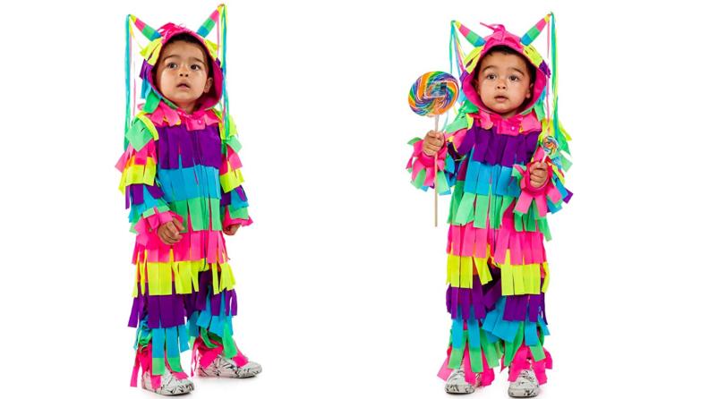 Child dressed as colorful piñata.
