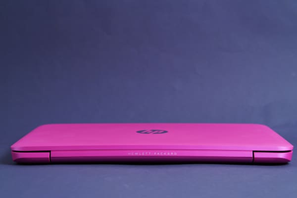 The HP branding is minimal and complements the pink exterior.