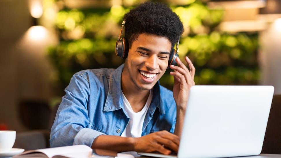 Teenager smiling at computer