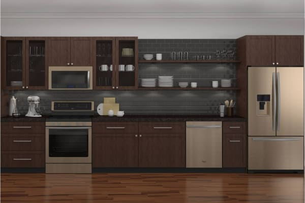 Sunset Bronze in a kitchen with dark wood cabinets