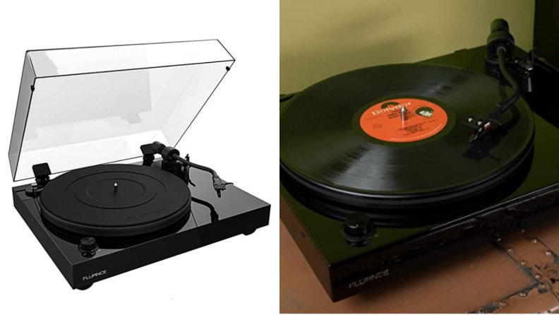 Record player with top open sitting on a table.