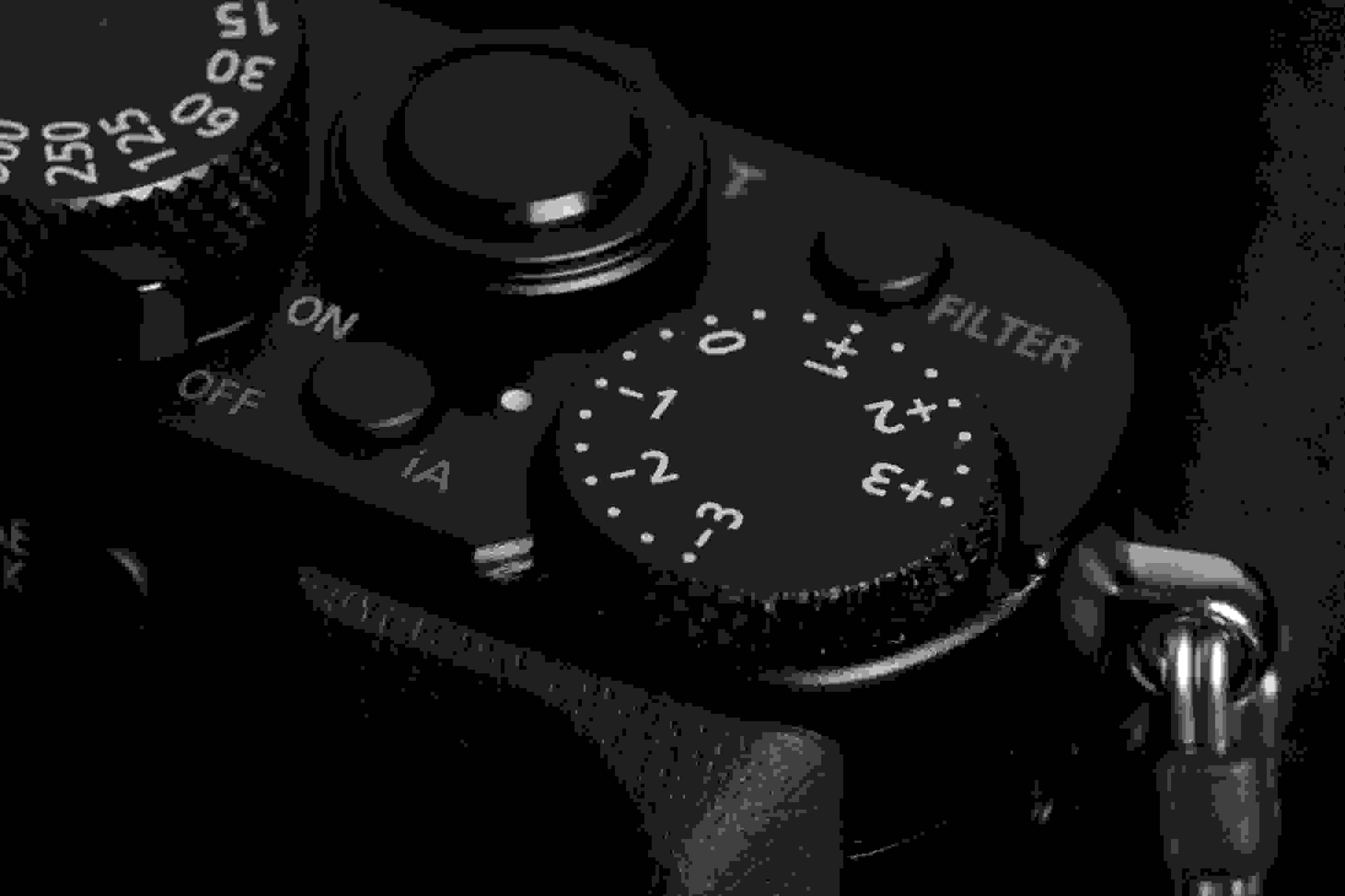 A photograph of the Panasonic Lumix LX100's exposure compensation dial.