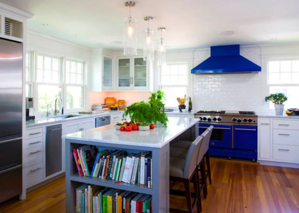 A LG oven offers a pop of color in a white kitchen
