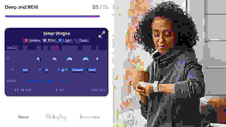 A woman looking at her Fitbit Charge 5.