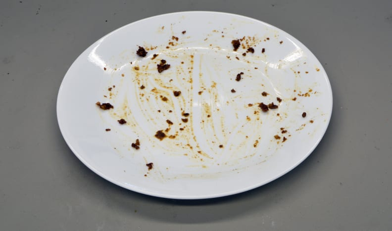 A plate stained with meat